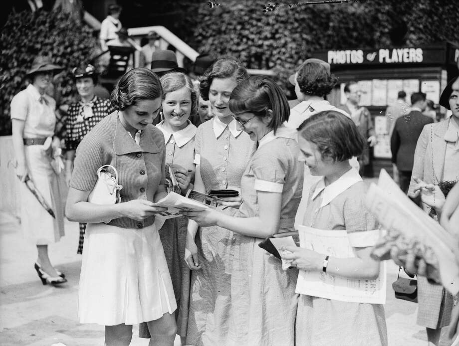 British tennis player Kay Stammers signing autographs for eager young tennis fans at Wimbledon. Photo: Fox Photos, Getty Images / Hulton Archive