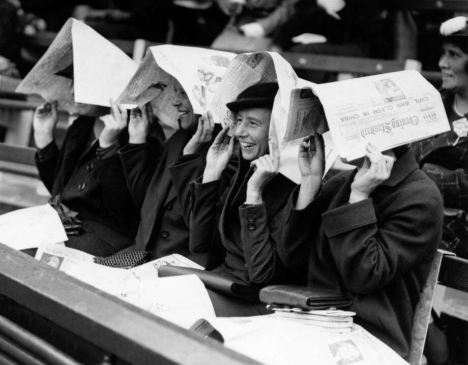 Rain has always been an issue during the fortnight. Here a group of spectators watching a tournament at Wimbledon in 1936. Photo: Derek Berwin, Getty Images / Hulton Archive
