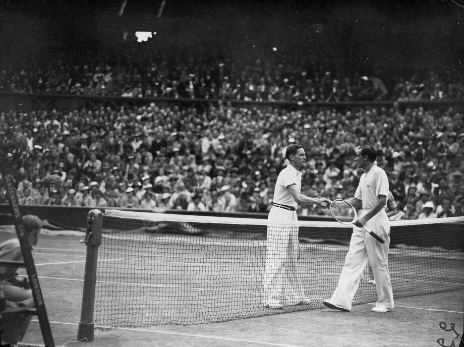 Von Cramm shakes hands with Britain's Fred Perry after Perry's victory in the men's singles final on the Centre Court at the Wimbledon Lawn Tennis Championships. And thus began the great British drought at Wimbledon. Photo: A. Hudson, Getty Images / Hulton Archive