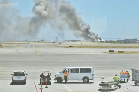 Smoke rises from the crash of Asiana Airlines Flight 214.