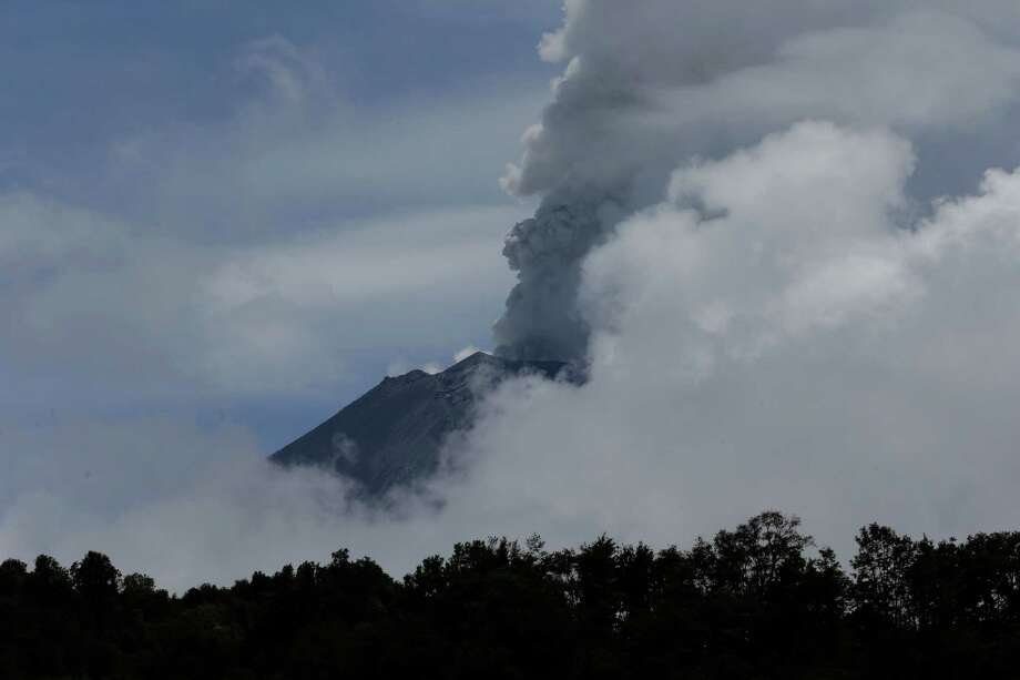 A plume of ash and steam rises from the Popocatepetl volcano during a brief view from cloud cover as seen from the town of Santiago Xalizintla, Mexico, Saturday, July 6, 2013. Just east of Mexico City, the volcano has spit out a cloud of ash and vapor 2 miles (3 kilometers) high over several days of eruptions. Mexico's National Center for Disaster Prevention raised the volcano alert from Stage 2 Yellow to Stage 3 Yellow, the final step before a Red alert, when possible evacuations could be ordered. Photo: AP
