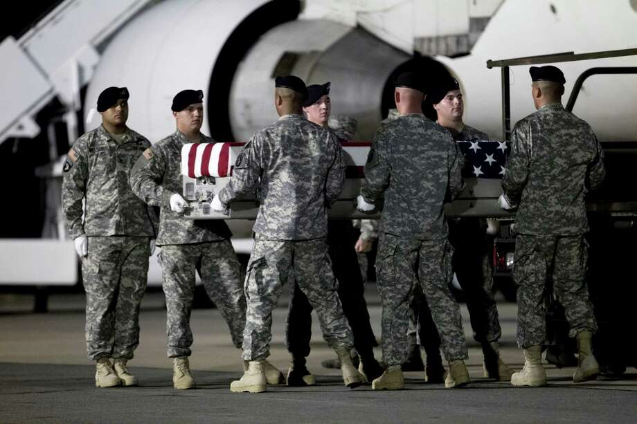 An Army carry team carries the transfer case containing the remains of Army Pvt. Errol D. Milliard of Birmingham, Ala. upon arrival at Dover Air Force Base, Del. on Saturday, July 6,  2013. The Department of Defense announced the death of Milliard who was supporting Operation Enduring Freedom in Afghanistan. Photo: AP