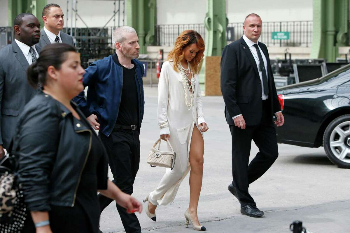 Singer Rihanna, second right, arrives for Chanel's Haute Couture Fall-Winter 2013-2014 collection, presented Tuesday, July 2, 2013 in Paris.