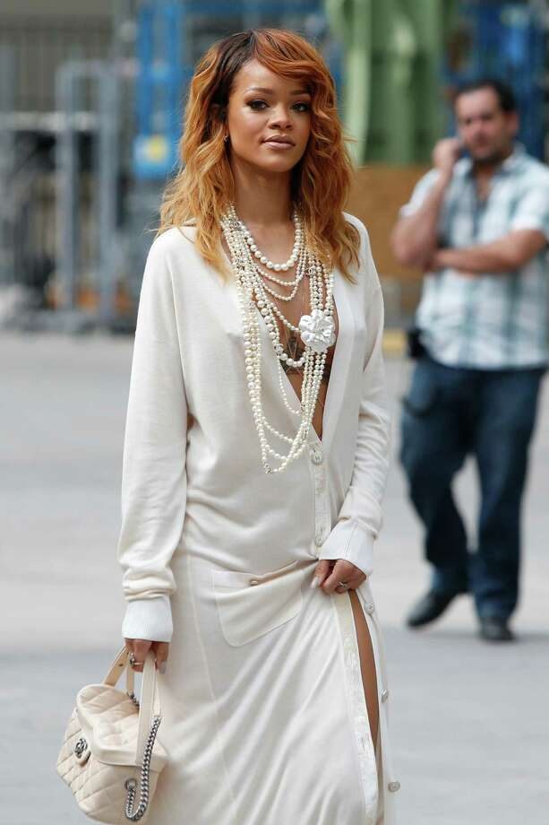 Singer Rihanna arrives to pose for photographers prior to attending Chanel's Haute Couture Fall-Winter 2013-2014 collection, presented Tuesday, July 2, 2013 in Paris. Photo: AP