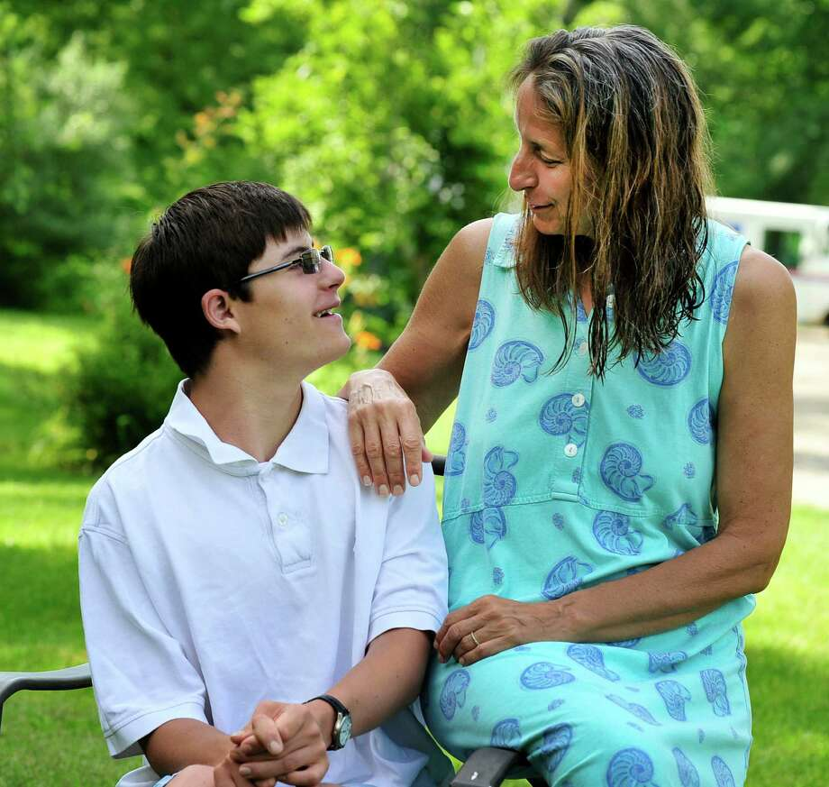 Justin Isaac, 19, of Bridgewater, has faced many challenges in his life and is an inspiration to many.  He recently graduated from high school.  Here, he talks with his mom, Lori, in Roxbury, Conn. Saturday, July 6, 2013. Photo: Michael Duffy / The News-Times