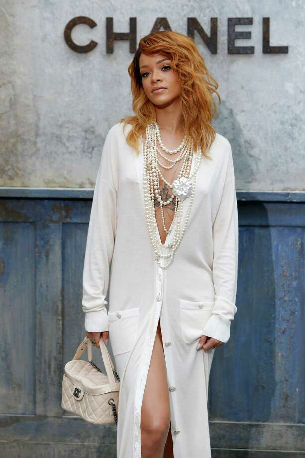 Singer Rihanna poses for photographers as she arrives to attend Chanel's Haute Couture Fall-Winter 2013-2014 collection, presented Tuesday, July 2, 2013 in Paris. Photo: AP