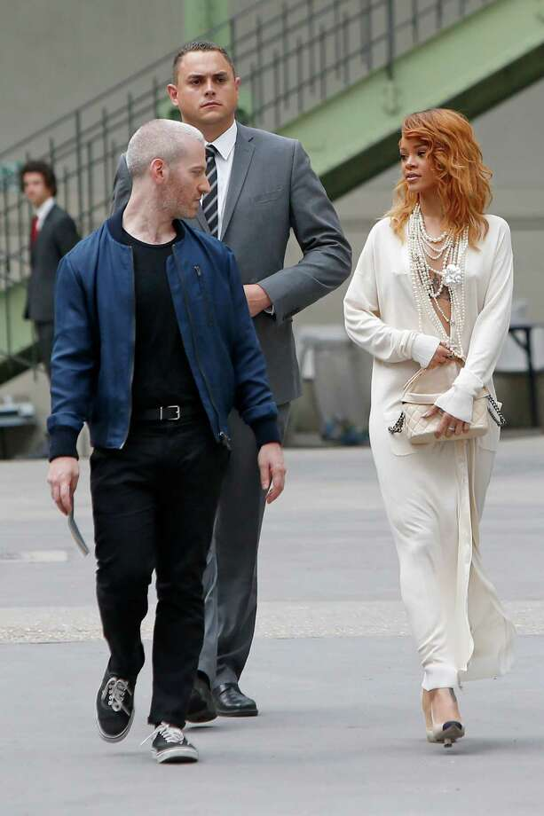 Singer Rihanna, right, and Mel Ottenberg, left,  arrive to attend Chanel's Haute Couture Fall-Winter 2013-2014 collection, presented Tuesday, July 2, 2013 in Paris. Photo: AP