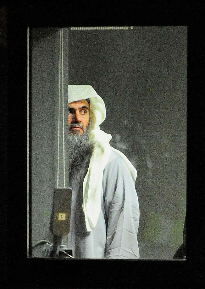 LONDON, ENGLAND - JULY 7:  (NO SALES) (EDITORIAL USE ONLY)  In this handout image provided by the MoD, radical cleric Abu Qatada (L) prepares to board a plane at RAF Northolt which will take him to Jordan, after he was deported from the UK to face terrorism charges in his home country, on July 7, 2013 in London, England. (Photo by Sgt Ralph Merry/MoD via Getty Images) Photo: Handout, Getty Images