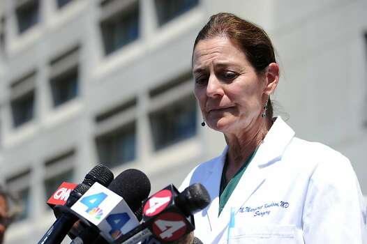 Chief of Surgery Dr. Margaret Knudson briefs the media outside San Francisco General Hospital. Photo: Michael Short, Special To The Chronicle