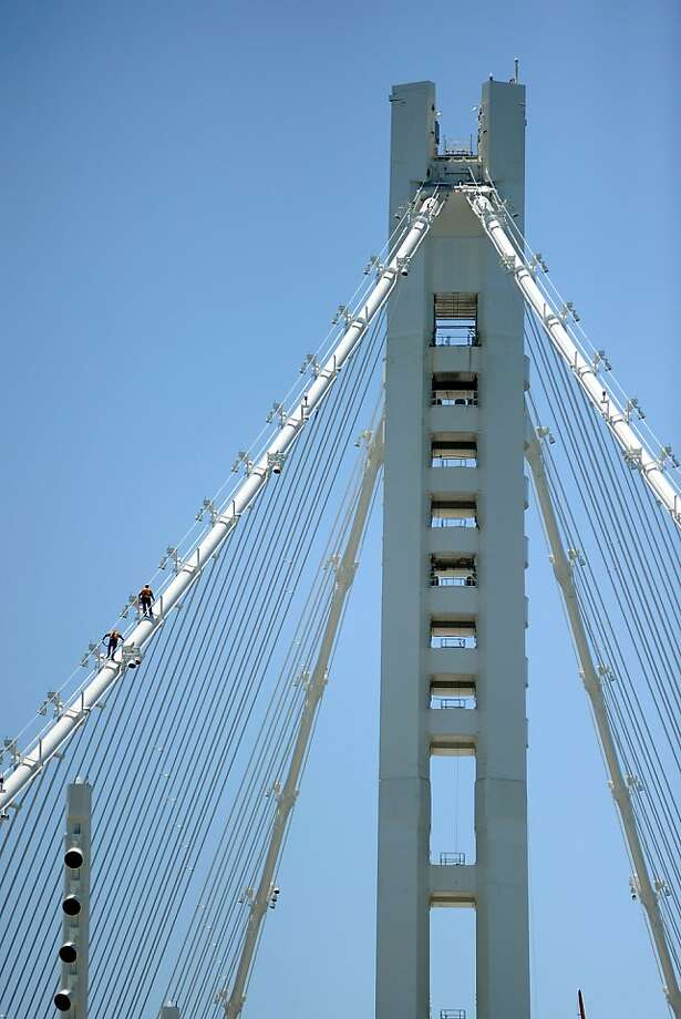 Workers walk up the suspension cable on the tower structure of the new eastern span of the Bay Bridge in Oakland, CA Saturday May 18th, 2013. Photo: Michael Short, Special To The Chronicle