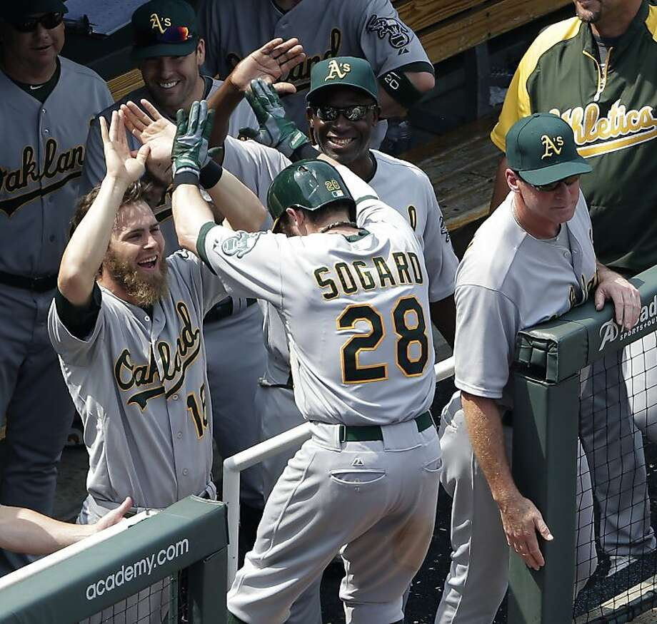 Eric Sogard's two-run homer in the seventh inning broke open the game for the A's, who took two of three in the series. Photo: Charlie Riedel, Associated Press