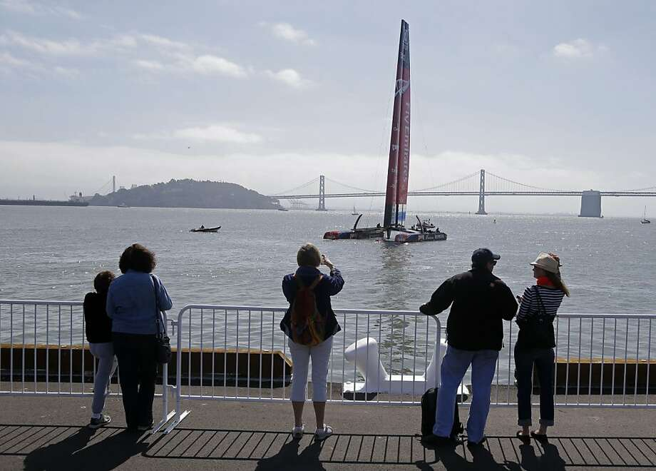It was a great day on the bay - so what if there was only one boat to watch? Emirates Team New Zealand's AC72 catamaran provided the eye candy. Photo: Eric Risberg, Associated Press