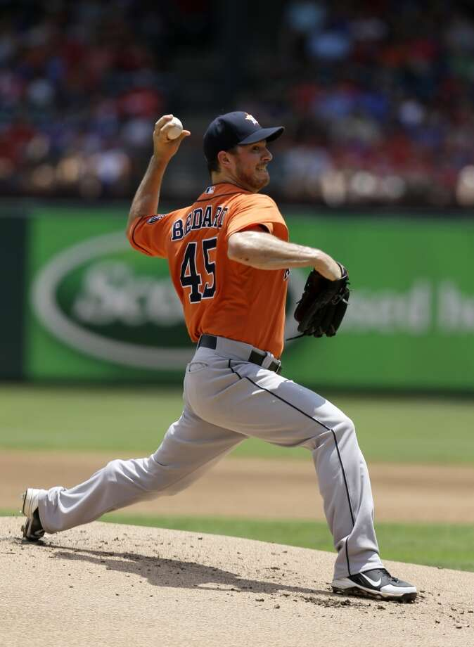 Astros pitcher Erik Bedard makes a throw to the Rangers.