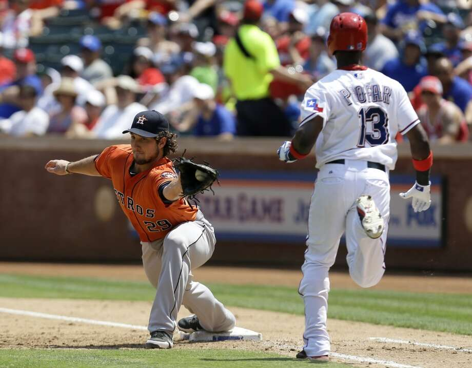 Astros first baseman Brett Wallace stretches of the bag for an out.