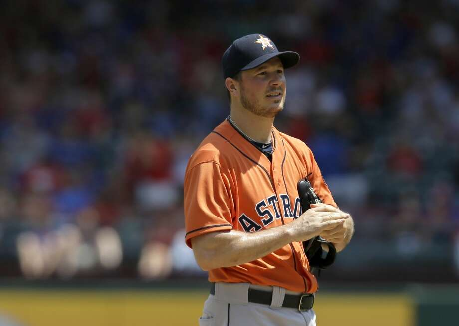 Astros pitcher Erik Bedard reacts after giving up a home run to the Rangers.