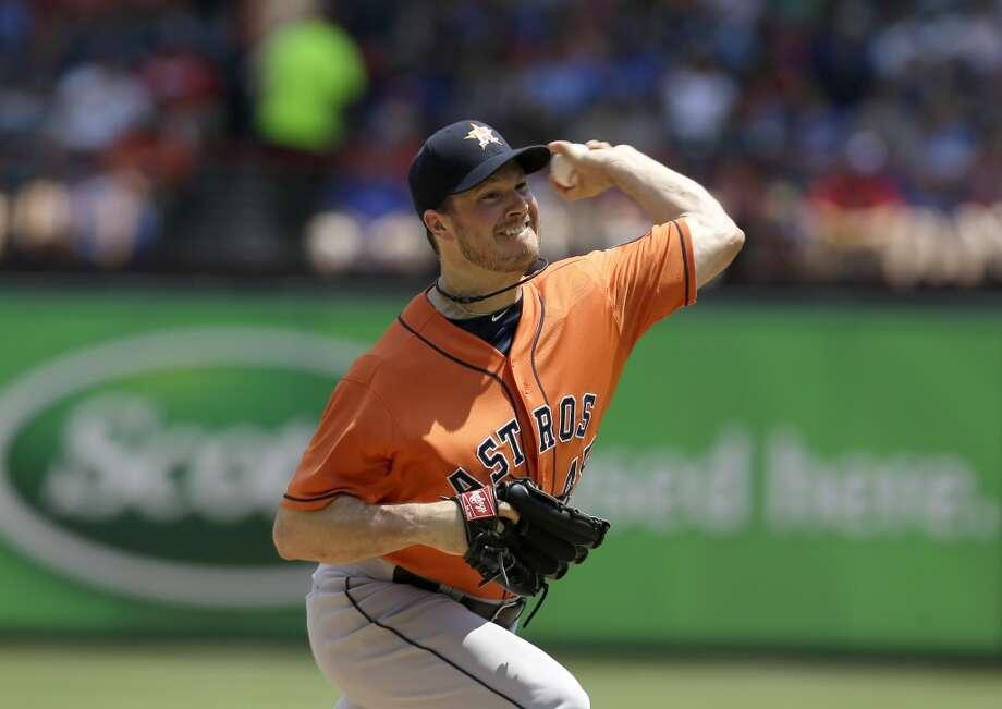 Astros pitcher Erik Bedard makes a throw to the Rangers.