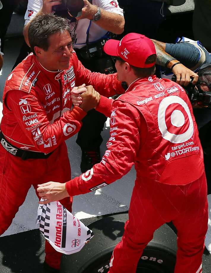 Scott Dixon, driver of the No. 9 Target car, is congratulated by a crew member. Photo: Elsa, Getty Images