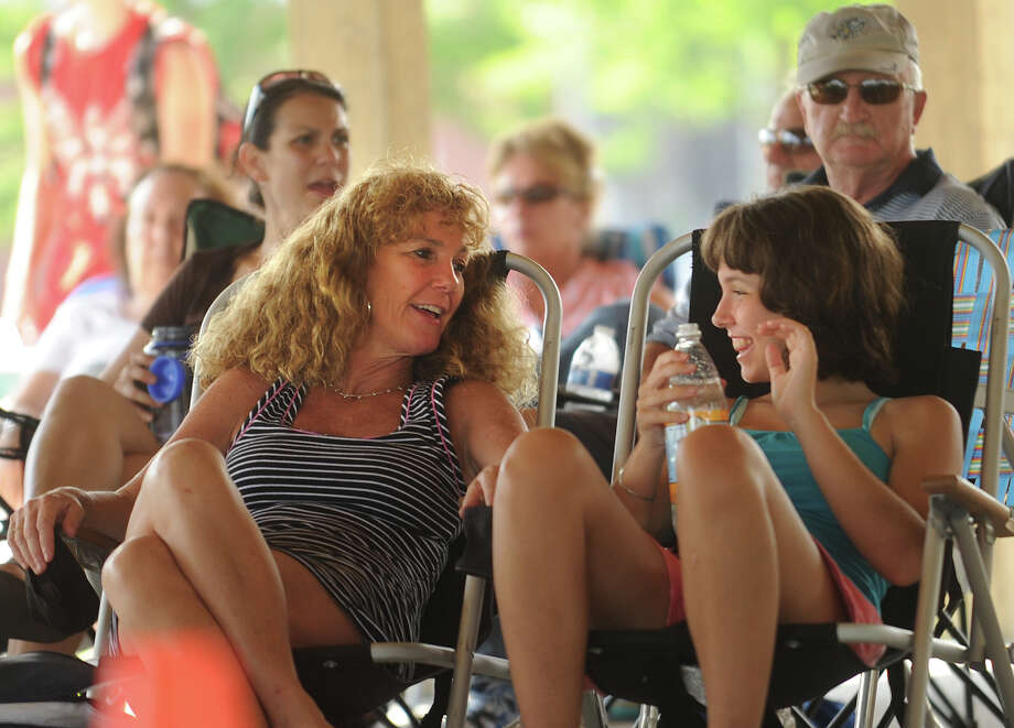 Eileen Murro and her daughter Olivia, 14, of Milford, chat during the opening of the summer weekly concert series at the Walnut Beach Pavilion in Milford, Conn. on Sunday, July 7, 2013. Photo: Brian A. Pounds / Connecticut Post