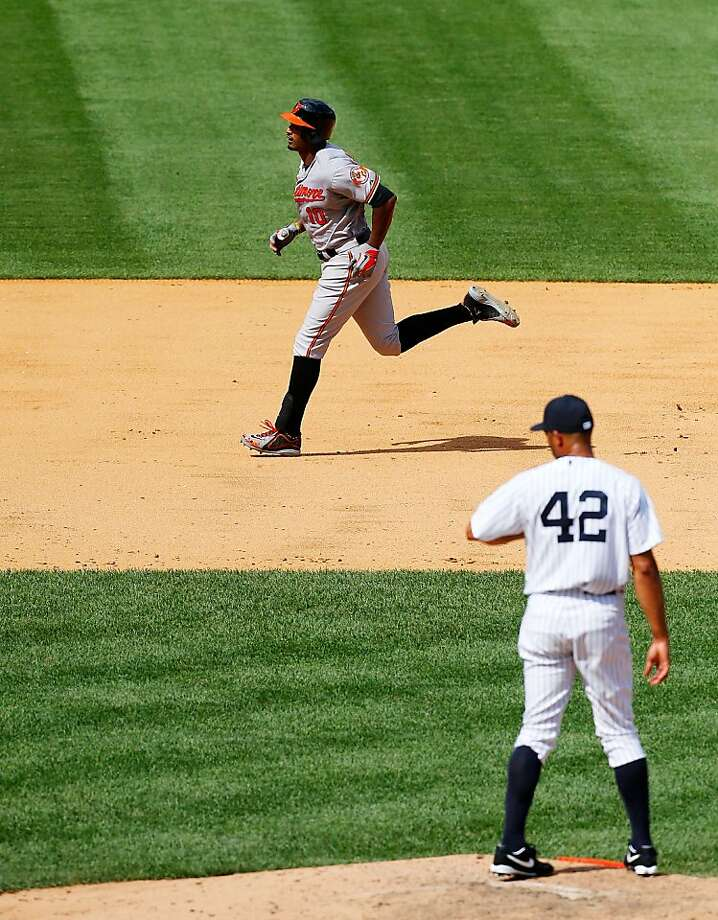 Adam Jones' two-run, ninth-inning home run off Mariano Rivera turned the Orioles' 1-0 deficit into a 2-1 victory Sunday over the Yankees in New York. Photo: Jim McIsaac, Getty Images