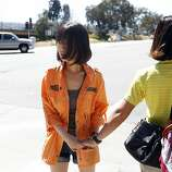 Hee Young, a survivor of the Asiana Boeing 777 crash landing, holds a friends hand after talking with the media outside of the Crowne Plaza hotel Burlingame, Calif. on July 7, 2013.