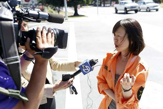 Hee Young, a survivor of the Asiana Boeing 777 crash landing, talks with the media outside of the Crowne Plaza hotel Burlingame, Calif. on July 7, 2013. Photo: Ian C. Bates, The Chronicle