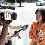 Hee Young, a survivor of the Asiana Boeing 777 crash landing, talks with the media outside of the Crowne Plaza hotel Burlingame, Calif. on July 7, 2013.