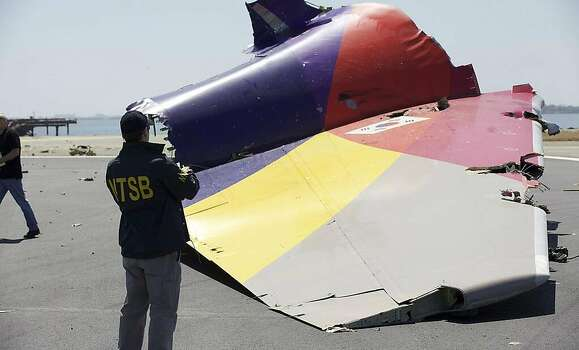 The National Transportation Safety Board tweeted photos of their investigation of Asiana airliner crash at San Francisco International Airport Saturday, July 6, 2013. This photograph shows the tail that was ripped off of the fuselage. Photo: NTSB