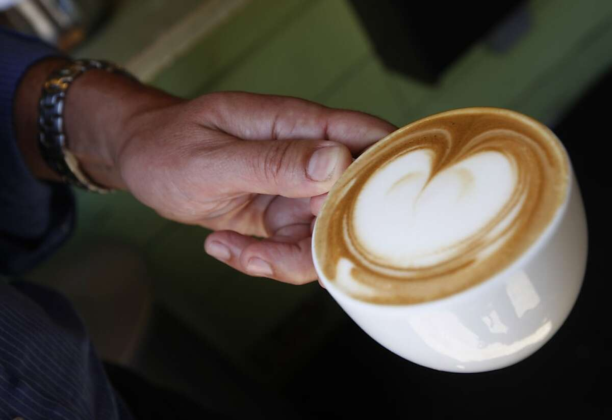 Christian Caiazzo is ready to drink his cappuccino at Toby's Coffee Bar in Point Reyes Station, Calif., on Friday, June 11, 2010. Caiazzo owns and operates the coffee bar at Toby's Feed Barn as well as the Osteria Stellina restaurant across the street.