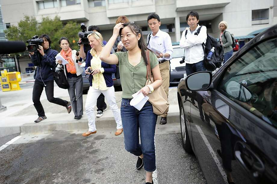 """Wen """"Kitty"""" Zhang was on the flight with five relatives and walked out the torn rear of the plane. Her 4-year-old broke his leg. Photo: Michael Short, Special To The Chronicle"""