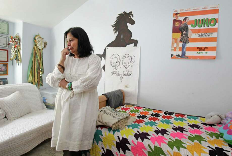 Naila Qureshi in her deceased daughter's room. Qureshi said her daughter's love of service came from the third pillar of Islam. Photo: Melissa Phillip, Staff / © 2013  Houston Chronicle