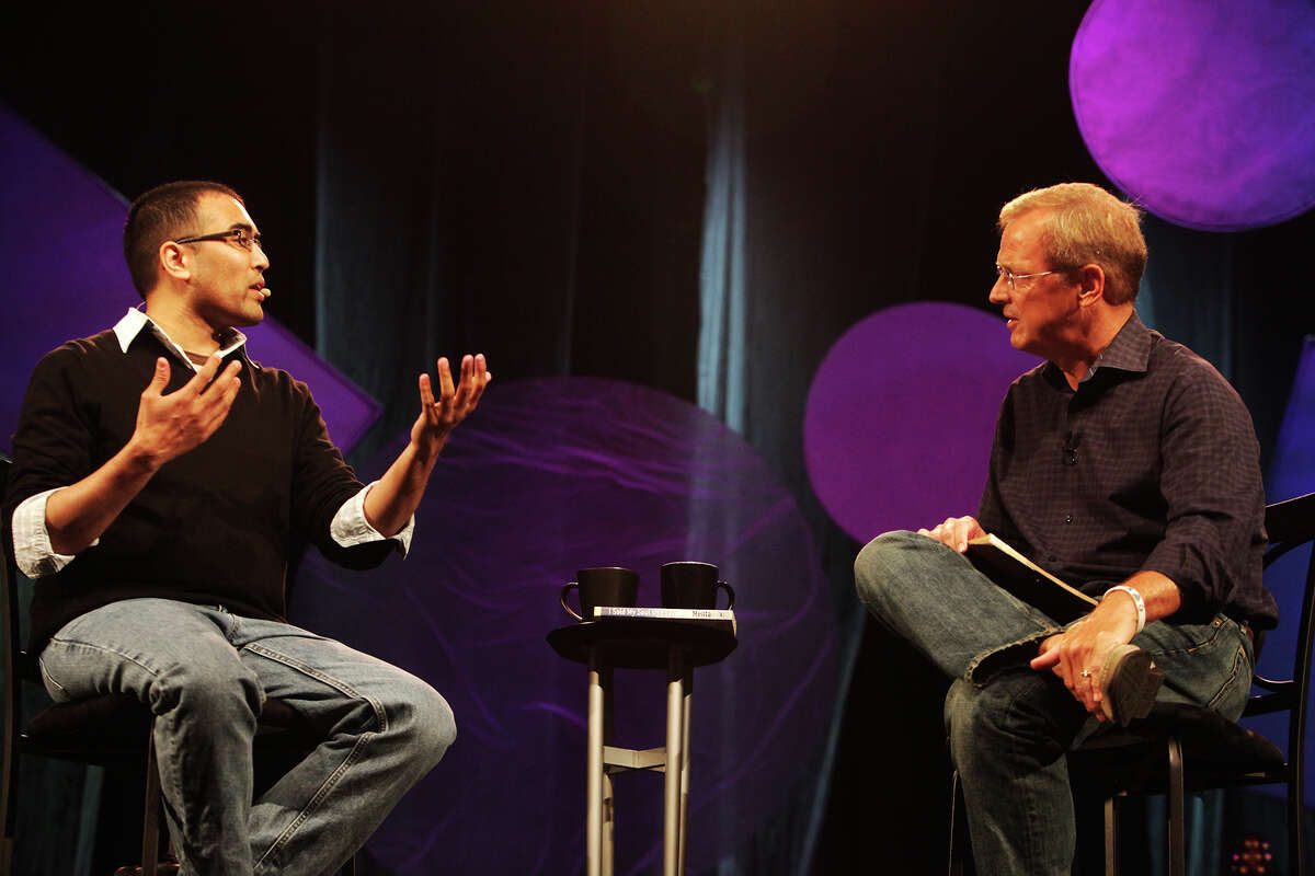 """Author Hemant Mehta speaks with pastor Randy Frazee at the Oak Hills Church on Sunday, July 7, 2013. Mehta is known as the """"friendly atheist"""" and met Frazee in Chicago years ago while attending a variety of churches chosen by the highest bidder on Ebay."""