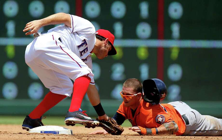 Rangers second baseman Ian Kinsler puts the tag on Brandon Barnes on a stolen-base attempt in the second inning, completing a double play after a strikeout of Matt Dom-inguez. Photo: Ronald Martinez, Staff / 2013 Getty Images