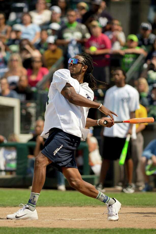 Seahawks cornerback Richard Sherman hits a home run during the Richard Sherman Celebrity Softball Game Sunday, July 7, 2013, at Cheney Stadium in Tacoma, Wash. The family-friendly event featured a home run derby with a portion of all proceeds going to Blanket Coverage, The Richard Sherman Family Foundation and Homes for Heroes. Photo: JORDAN STEAD, SEATTLEPI.COM / SEATTLEPI.COM
