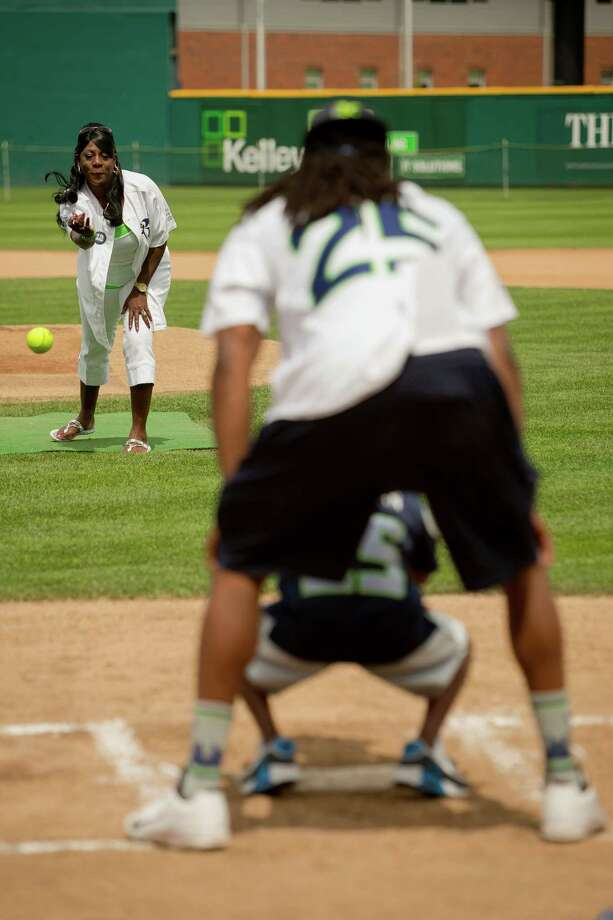 Beverly Sherman, Richard Sherman's mother, tosses out the first pitch at the Richard Sherman Celebrity Softball Game Sunday, July 7, 2013, at Cheney Stadium in Tacoma, Wash. The family-friendly event featured a home run derby with a portion of all proceeds going to Blanket Coverage, The Richard Sherman Family Foundation and Homes for Heroes. Photo: JORDAN STEAD, SEATTLEPI.COM / SEATTLEPI.COM