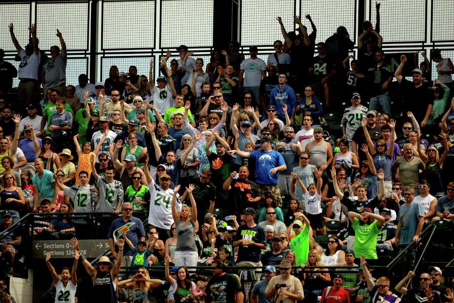 Under a blue sky, crowds cheer at the Richard Sherman Celebrity Softball Game Sunday, July 7, 2013, at Cheney Stadium in Tacoma, Wash. The family-friendly event featured a home run derby with a portion of all proceeds going to Blanket Coverage, The Richard Sherman Family Foundation and Homes for Heroes. Photo: JORDAN STEAD, SEATTLEPI.COM / SEATTLEPI.COM