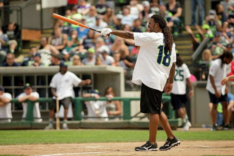 Seahawks wide receiver Sidney Rice warms up at home plate during the Richard Sherman Celebrity Softball Game Sunday, July 7, 2013, at Cheney Stadium in Tacoma, Wash. The family-friendly event featured a home run derby with a portion of all proceeds going to Blanket Coverage, The Richard Sherman Family Foundation and Homes for Heroes. Photo: JORDAN STEAD, SEATTLEPI.COM / SEATTLEPI.COM