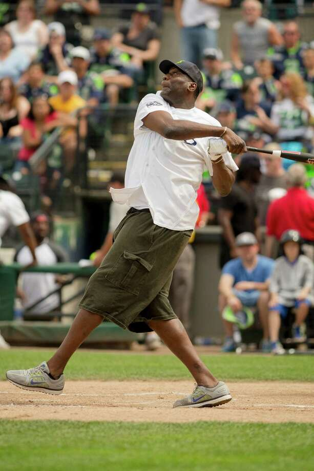 Retired Sonics basketball player Shawn Kemp takes a swing at a pitch during the Richard Sherman Celebrity Softball Game Sunday, July 7, 2013, at Cheney Stadium in Tacoma, Wash. The family-friendly event featured a home run derby with a portion of all proceeds going to Blanket Coverage, The Richard Sherman Family Foundation and Homes for Heroes. Photo: JORDAN STEAD, SEATTLEPI.COM / SEATTLEPI.COM