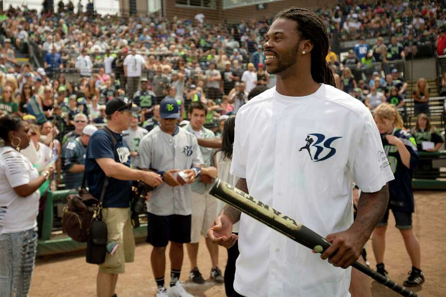 Seahawks wide receiver Sidney Rice steps onto the field before the Richard Sherman Celebrity Softball Game Sunday, July 7, 2013, at Cheney Stadium in Tacoma, Wash. The family-friendly event featured a home run derby with a portion of all proceeds going to Blanket Coverage, The Richard Sherman Family Foundation and Homes for Heroes. Photo: JORDAN STEAD, SEATTLEPI.COM / SEATTLEPI.COM