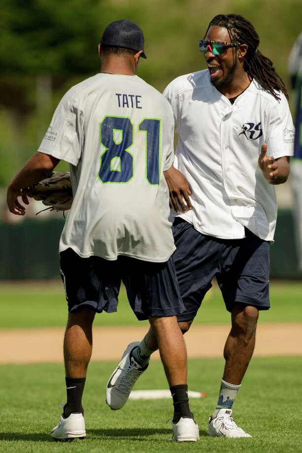 Seahawks cornerback Richard Sherman, right, jokes with Golden Tate, left, on his run around the bases at the Richard Sherman Celebrity Softball Game Sunday, July 7, 2013, at Cheney Stadium in Tacoma, Wash. The family-friendly event featured a home run derby with a portion of all proceeds going to Blanket Coverage, The Richard Sherman Family Foundation and Homes for Heroes. Photo: JORDAN STEAD, SEATTLEPI.COM / SEATTLEPI.COM
