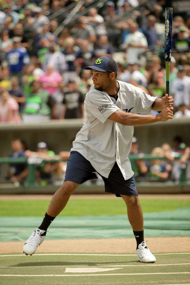 Golden Tate lines up for a home run at the Richard Sherman Celebrity Softball Game Sunday, July 7, 2013, at Cheney Stadium in Tacoma, Wash. The family-friendly event featured a home run derby with a portion of all proceeds going to Blank Coverage, The Richard Sherman Family Foundation and Homes for Heroes. Photo: JORDAN STEAD, SEATTLEPI.COM / SEATTLEPI.COM
