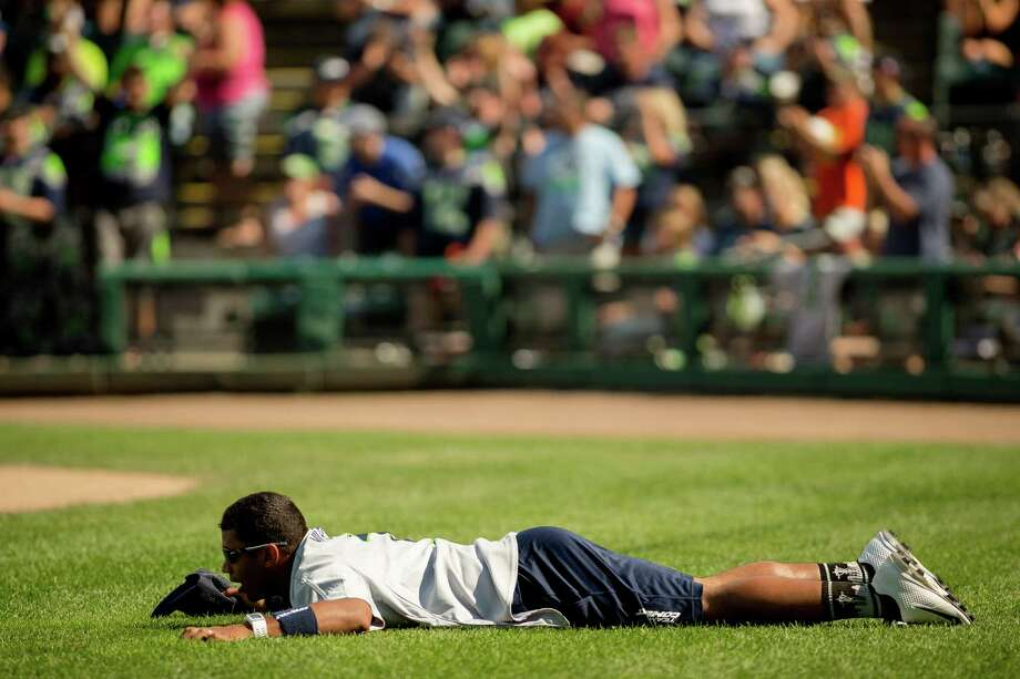 Exasperated, a floored Russell Wilson watches in disbelief at an unfavorable play against his teammates during the Richard Sherman Celebrity Softball Game Sunday, July 7, 2013, at Cheney Stadium in Tacoma, Wash. The family-friendly event featured a home run derby with a portion of all proceeds going to Blanket Coverage, The Richard Sherman Family Foundation and Homes for Heroes. Photo: JORDAN STEAD, SEATTLEPI.COM / SEATTLEPI.COM