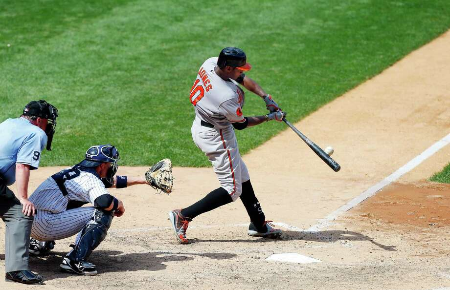 Adam Jones launches a two-run homer that helped the Orioles avoid a sweep in New York. Photo: Jim McIsaac, Stringer / 2013 Getty Images