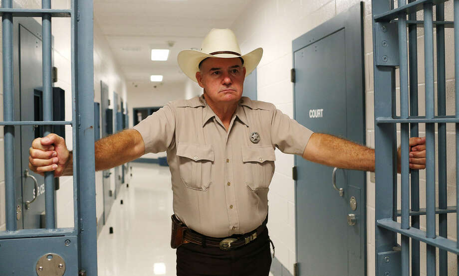 Live Oak County Sheriff Larry R. Busby personally handcuffed three of his male jail guards when they were arrested in a case in which female inmates claimed they were sexually abused. Photo: Photos By Jerry Lara / San Antonio Express-News