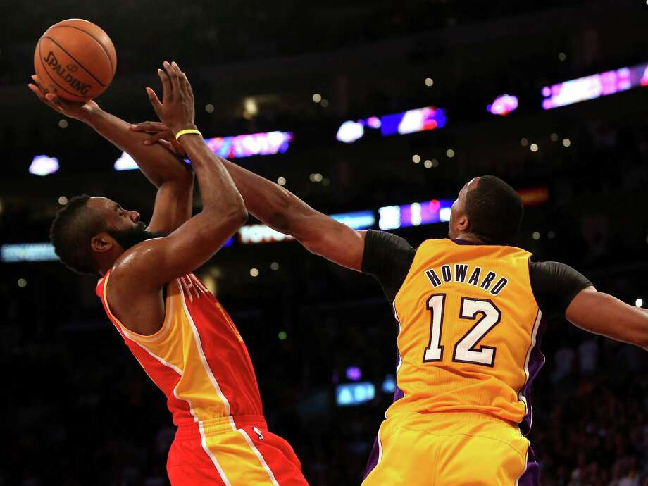 FILE - JULY 05: According to reports, superstar center Dwight Howard will sign with the Houston Rockets, July 5, 2013. LOS ANGELES, CA - APRIL 17:  James Harden #13 of the Houston Rockets shoots over Dwight Howard #12 of the Los Angeles Lakers at Staples Center on April 17, 2013 in Los Angeles, California. The Lakers won 99-95 in overtime.   NOTE TO USER: User expressly acknowledges and agrees that, by downloading and or using this photograph, User is consenting to the terms and conditions of the Getty Images License Agreement.  (Photo by Stephen Dunn/Getty Images) Photo: Stephen Dunn, Staff / 2013 Getty Images