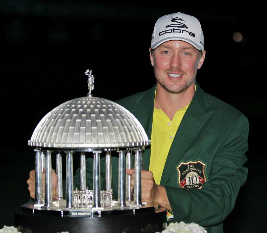 Jonas Blixt, of Sweden, holds the trophy after winning the Greenbrier Classic PGA golf tournament in White Sulphur Springs, W.Va., Sunday, July 7, 2013. Blixt overcame a four-shot deficit at the start of the final round and finished at 13 under. (AP Photo/Steve Helber) Photo: Steve Helber, STF / AP