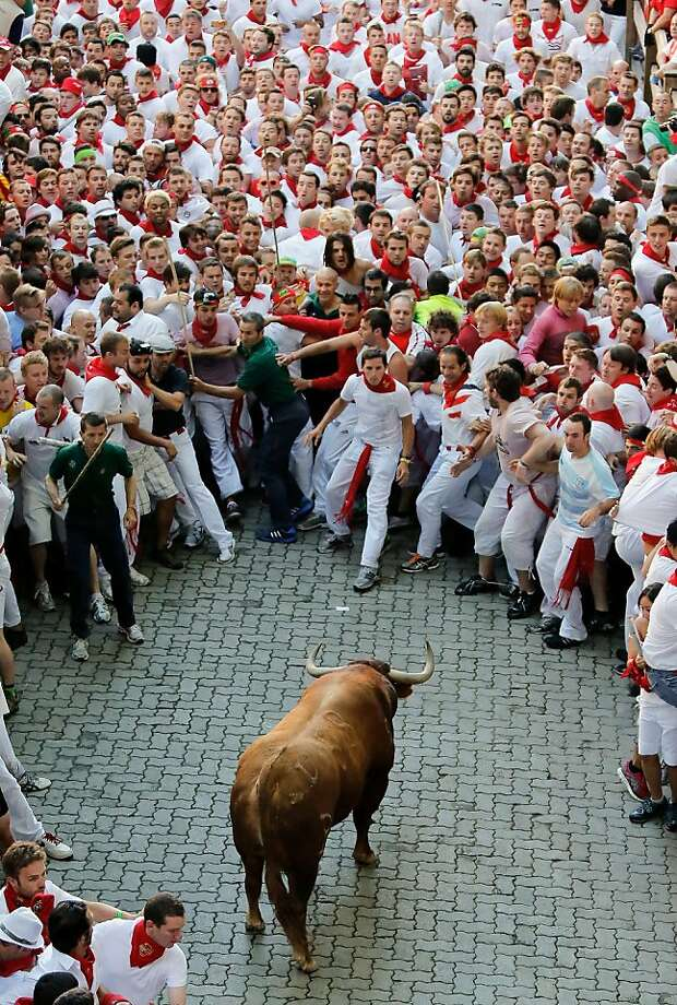 Who wants to be first?A provoked bull confronts the cowering in Pamplona. Photo: Pablo Blazquez Dominguez, Getty Images