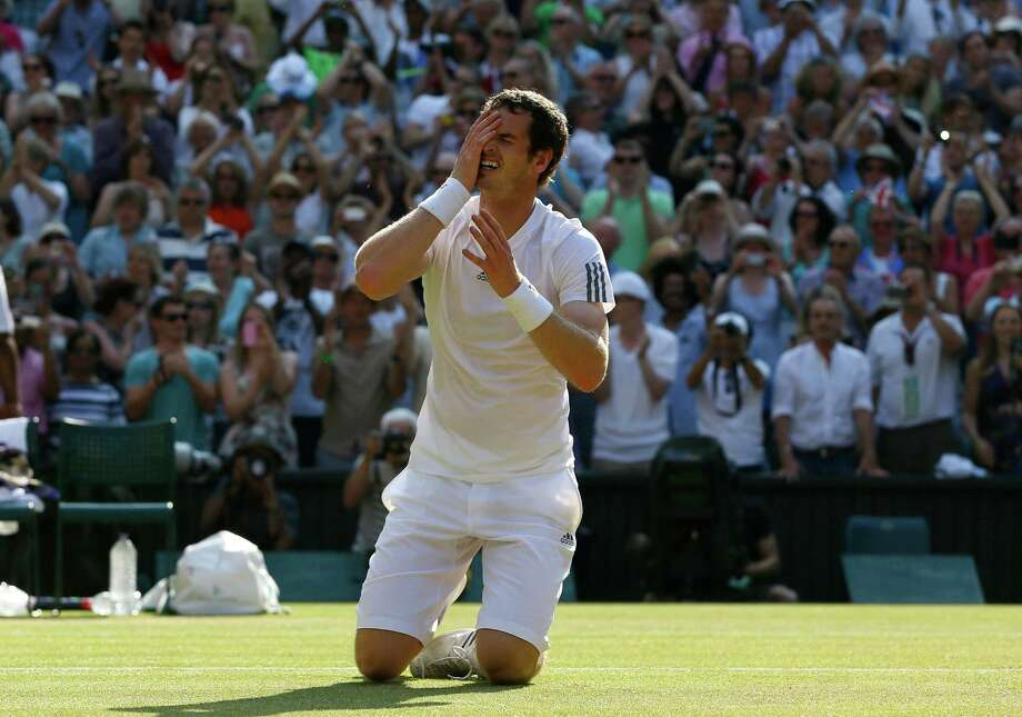 The grass surface that had been the scene of so many foiled British hopes through the years was conquered by Andy Murray in convincing fashion Sunday. Photo: Kirsty Wigglesworth, STF / AP