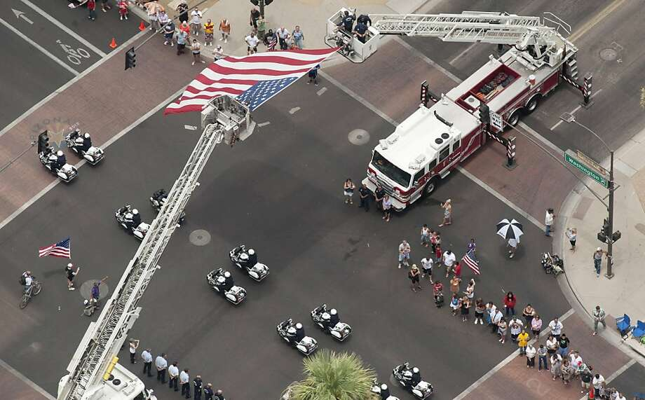 PHOENIX, AZ - JULY 7: A procession moves through Phoenix, Arizona under escort by the Joint Arizona Honor Guard, for the 19 fallen firefighters of the Granite Mountain Hotshots crew on July 7, 2013 in Phoenix, Arizona. The firefighters are transported by 19 hearses, each accompanied by motorcycle escorts from various agencies from Phoenix, Arizona to Prescott, Arizona. Nineteen of the twenty member crew died battling a fast-moving wildfire near Yarnell, Arizona on Sunday June 30th. (Photo by Laura Segall/Getty Images) Photo: Laura Segall, Getty Images