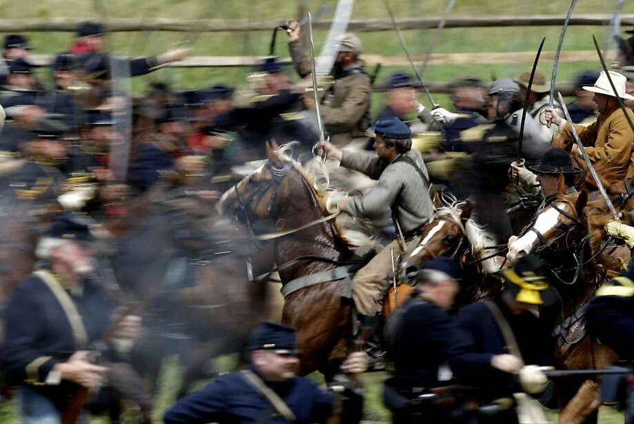 Re-enactors take part in a demonstration of a cavalry battle during ongoing activities commemorating the 150th anniversary of the Battle of Gettysburg, Sunday, July 7, 2013, at Redding Farm in Gettysburg, Pa.  Union forces turned away a Confederate advance in the pivotal battle of the Civil War fought July 1-3, 1863, which was also the war's bloodiest conflict with more than 51,000 casualties. (AP Photo/Matt Rourke) Photo: Matt Rourke, Associated Press