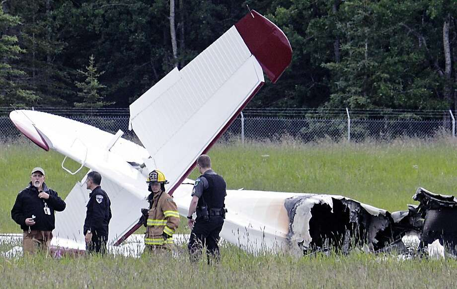 Emergency personnel survey the remains of a fixed-wing aircraft that crashed in Soldotna, Alaska, killing all 10 people aboard. Soldotna is a popular base for summer fishing expeditions. Photo: Rashah McChesney, Associated Press